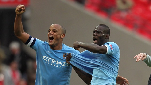 LEADER: Kompany celebrates the 2011 FA Cup win