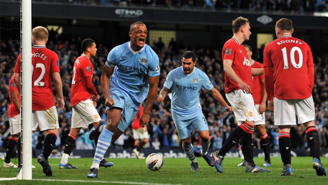 CAPTAIN KOMPANY: The skipper heads City to a 1-0 win against Manchester United in 2012