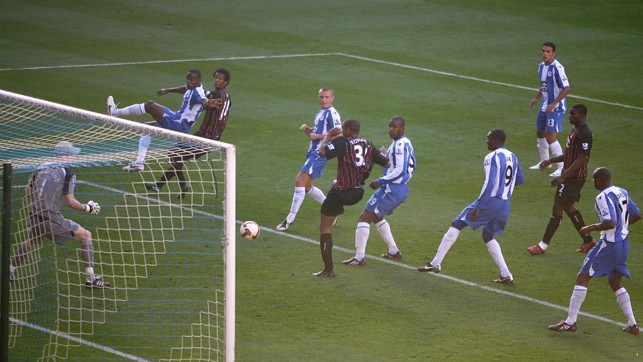 TAP IN: Kompany squeezes the ball in for his first City goal against Wigan in 2008