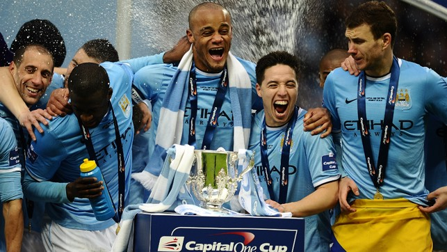 ALL SMILES: The team prepare to lift the League Cup trophy in 2014