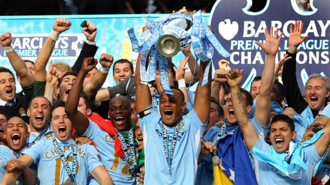 ECSTASY: The Belgian lifts the Premier League trophy aloft in 2012