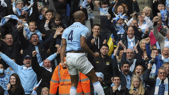 SQUAD LEADER: Kompany scores to help secure the Premier League title in 2014