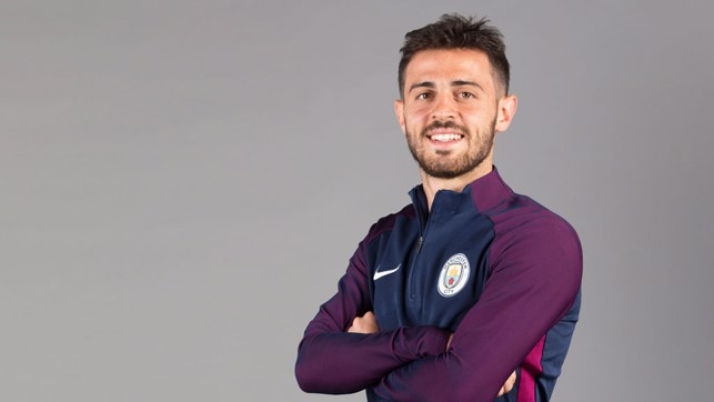 CROSS THOSE ARMS: Silva looking happy in City gear