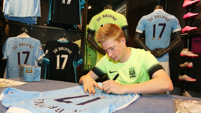 SHIRT SIGNING: Kevin De Bruyne signs a shirt on contract signing day