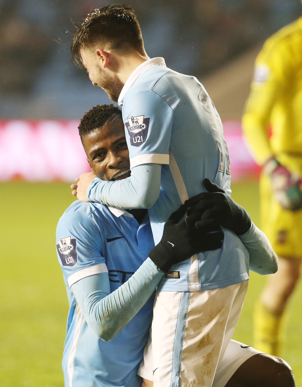 BIG HUG: Roberts and Iheanacho embrace during a City EDS game in 2015