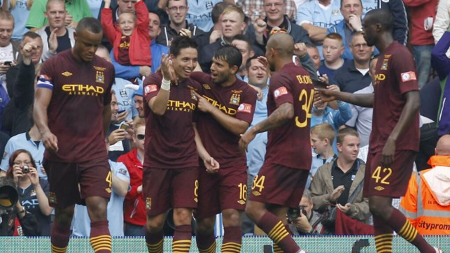 MOBBED: Congratulated after scoring in the 2012 Community Shield win