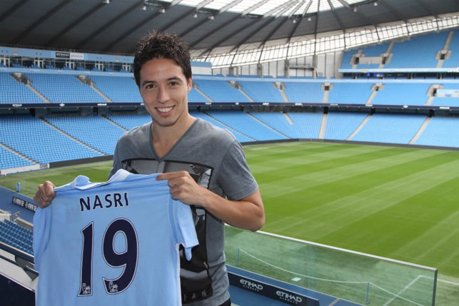 SIGNING: Nasri beams after joining the Blues in 2011