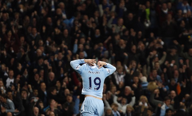 CROWD PLEASER: Nasri runs towards the fans after scoring against Chelsea in 2012