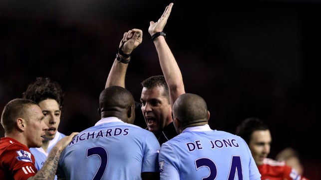 HANDS UP! Referee Phil Dowd is surrounded during a League Cup game in 2012