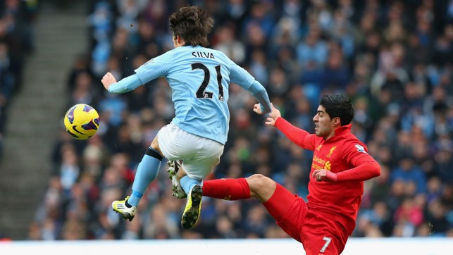 CATCH ME IF YOU CAN: David Silva leaps over the challenge of Luis Suarez in 2013