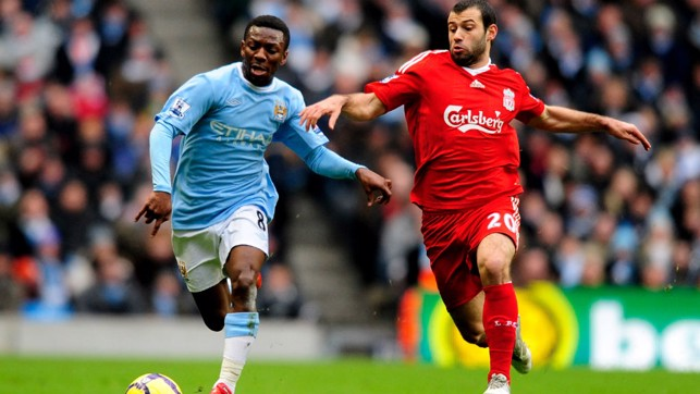 FOOT RACE: Shaun Wright-Phillips sprints clear of Javier Mascherano in 2010
