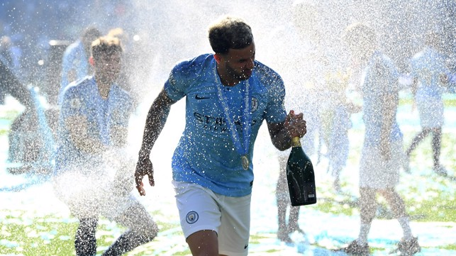 CHAMPAGNE SUPERNOVA: Kyle gets drenched at Brighton