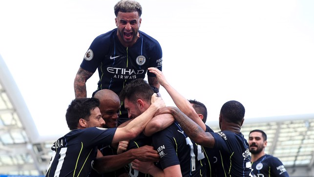 FLYING HIGH: Kyle joins the celebrations as the title is sealed