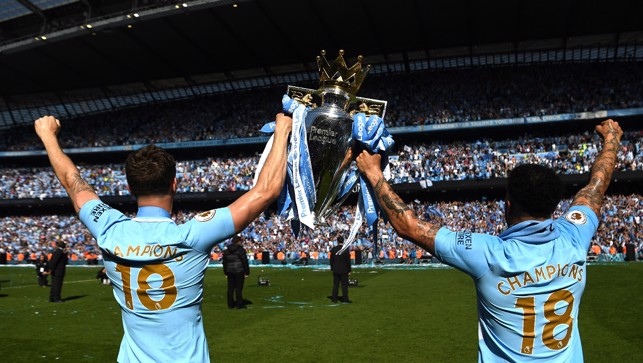 BROTHERS IN ARMS: Celebrating the title with pal John Stones