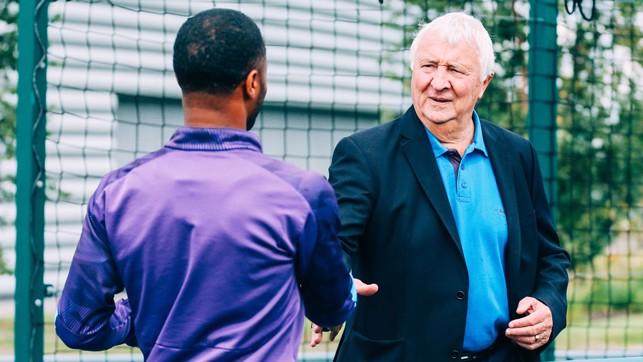 LEGEND: Raheem Sterling greets Mike Summerbee.