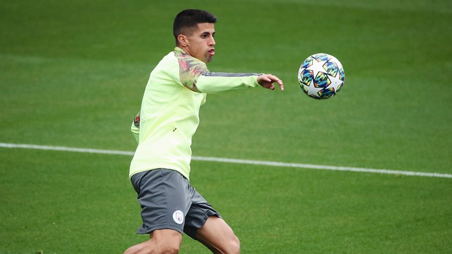 STAR GAZING: Joao Cancelo focuses on the interestingly decorated ball
