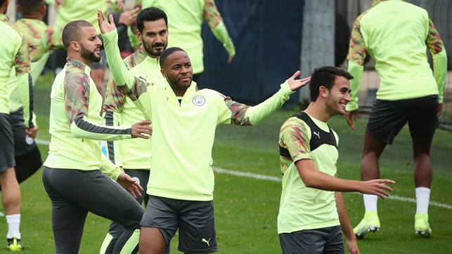 WHAT'S THE DEAL? Raheem seems to be asking a team-mate something