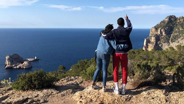 REACH THE SKIES: Raheem and partner Paige on holiday