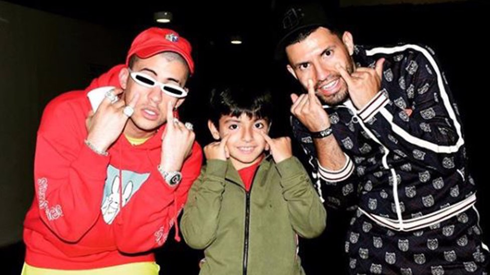 BAD BUNNY: Sergio Aguero and son Benjamin pose with the musician