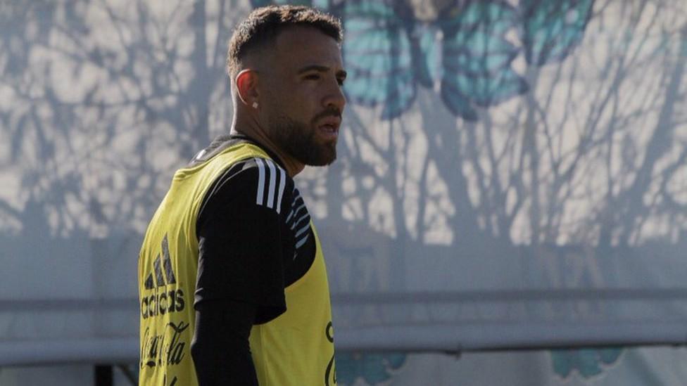 LOOKING ON: Nicolas Otamendi looks on during training