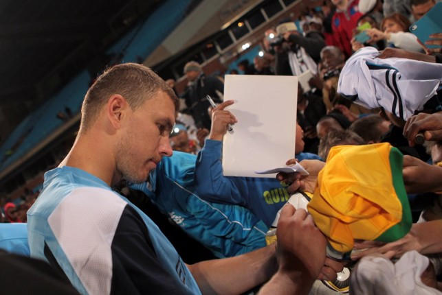 2013: Edin Dzeko signing for fans at Loftus Stadium.