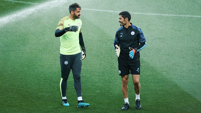 GLOVE STORY: Goalkeeper Scott Carson and goalkeeping coach Xabier Mancisidor talk through Tuesday's training session