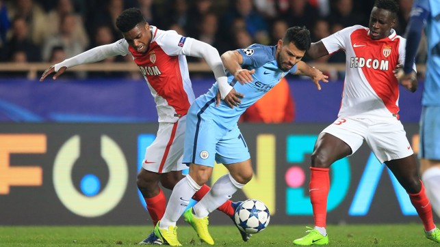 CATCHING THE EYE: Mendy and Aguero tussle for the ball