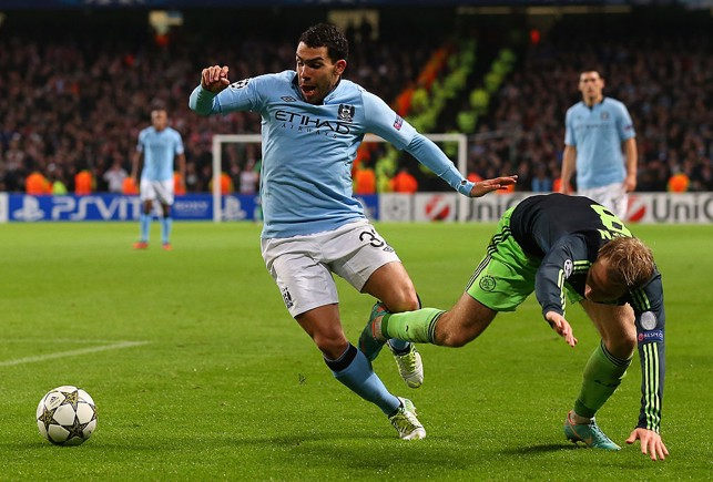 FIGHT: Carlos Tevez fights for the ball against Ajax in 2012