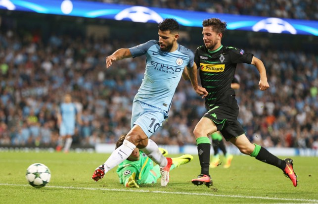 RAIN DELAY: Sergio Aguero scores against Monchengladbach the day after the match was called off due to large amounts of rain.