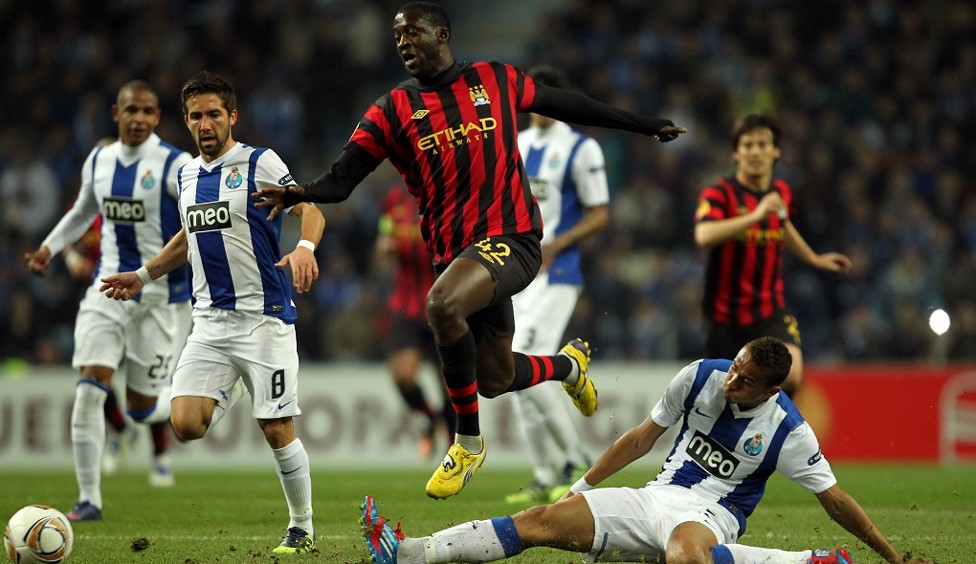 2012: Challenging Yaya Toure as City take on Porto in the Round of 32 Europa League tie in Portugal