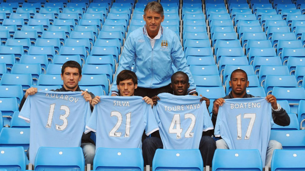 DONE DEAL: David Silva first signed for City back in the Summer of 2010, here is he pictured with fellow signings Aleksandar Kolarov, Yaya Toure and Jerome Boateng and former boss Roberto Mancini.