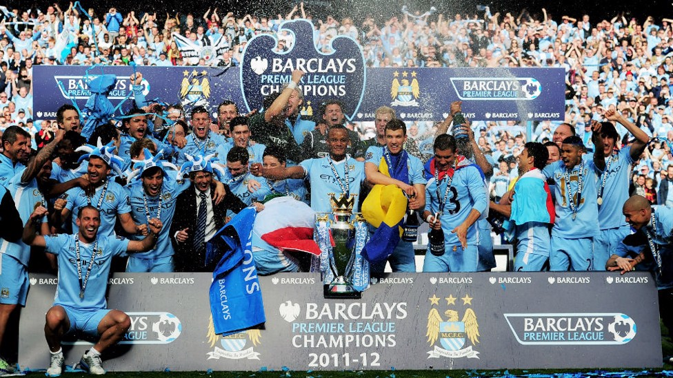 SPOT SILVA: Can you see our Spanish midfielder after we won the 2011/12 Premier League, a clue - he is sporting some fancy headgear.