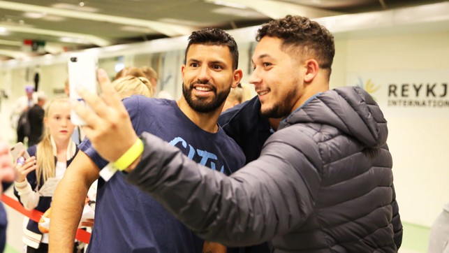 SELFIE WITH SERGIO: Aguero takes time out after the session for a photo with this fan.