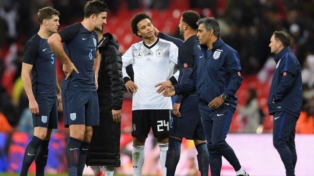 REUNITED BLUES: Kyle Walker and John Stones met City team mates Leroy Sane and Ilkay Gundogan during England and Germany's 0-0 friendly.