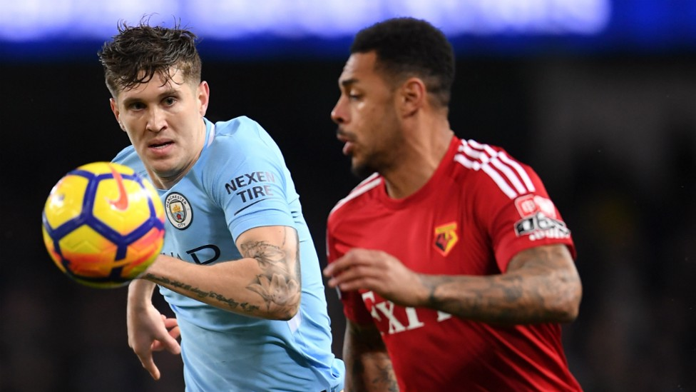 FOCUSED: The defender looks to shield the ball from Andre Gray