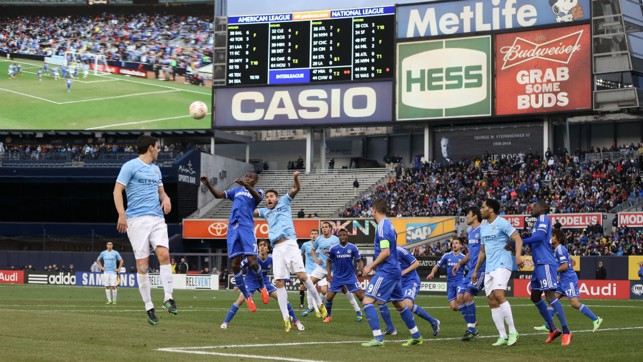 NEW YORK, NEW YORK: Gareth Barry meets a corner during the 2013 end of season visit to the States for two games against Chelsea.
