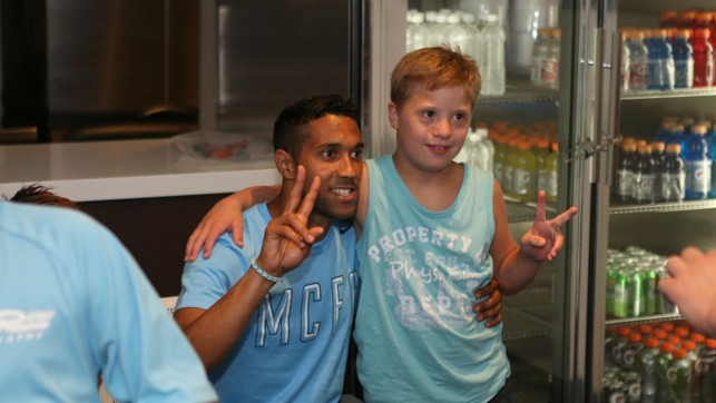 MEET AND GREET: Gael Clichy poses for a photo with fans in Kansas.