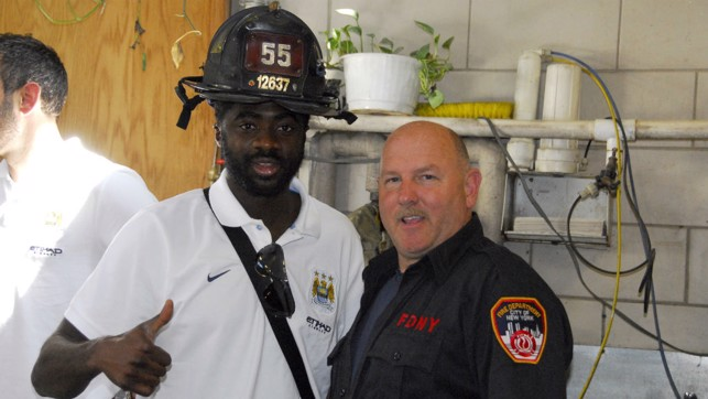 DEFENDERS: Kolo Toure gives the New York Fire Deparment the thumbs up in 2013.