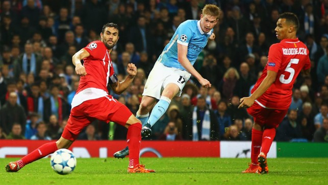 FLYING HIGH: De Bruyne scores his first Champions League goal for City against Sevilla
