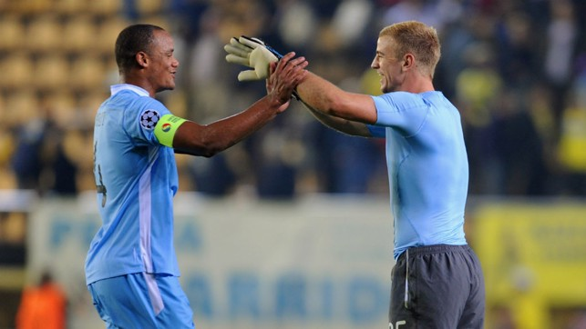 VICTORY: Celebrating a first away victory in the tournament - a 3-0 win at Villarreal - with Joe Hart.