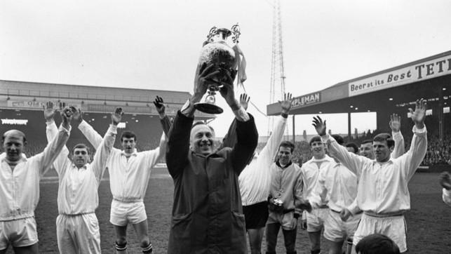 1968: Club legend Joe Mercer lifts the Premier League trophy at Maine Road.