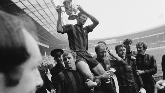 1970: Lifting the League Cup trophy at Wembley after sealing a win over West Brom.