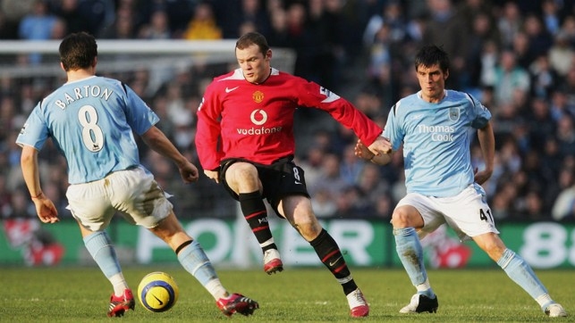 HEAD-TO-HEAD: Joey Barton takes on Wayne Rooney in City's 3-1 win early in 2006.