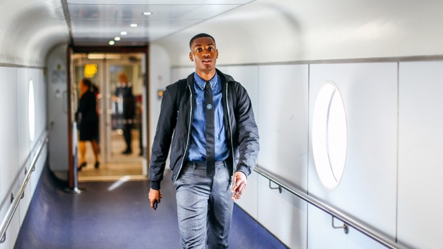 SUAVE: Tosin looking fresh as he walks through Manchester Airport