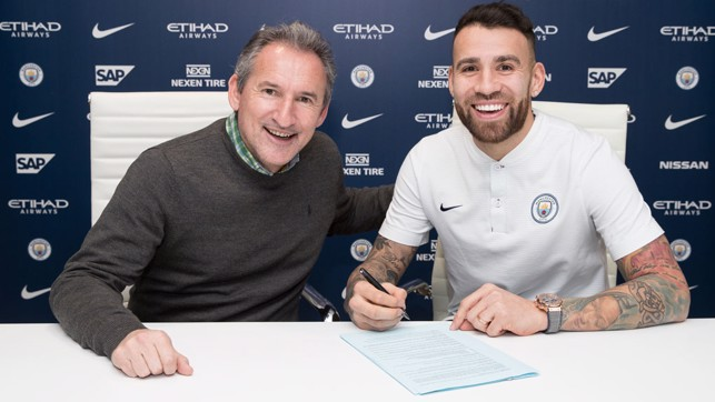 DONE DEAL: Adding his signature alongside Txiki Begiristain.