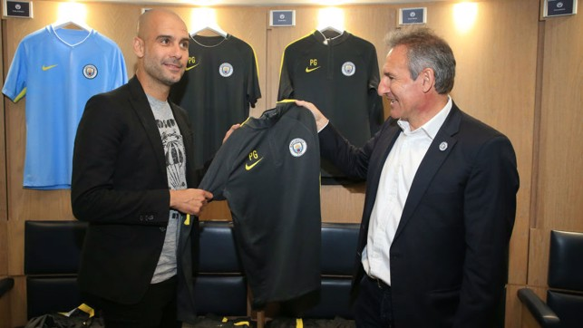 NEW THREADS: In 2016, Pep receives his personalised kit ready for his new role.