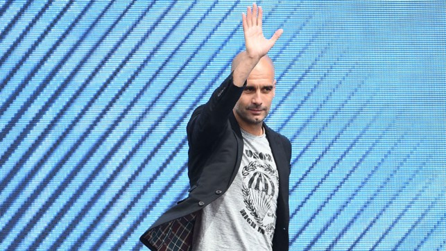 UNVEILING: Pep answers questions at City Square after arriving at the club.