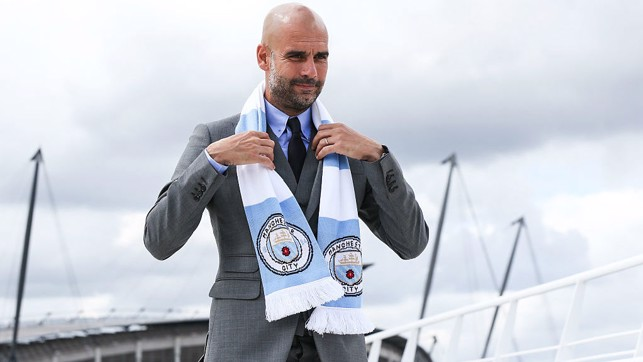 WELCOME: Pep poses in front of the Etihad back in 2016.