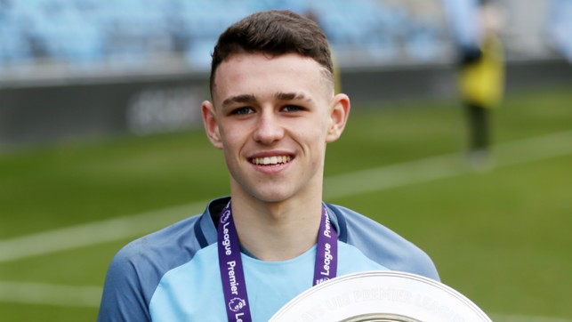 SILVERWARE: The youngster helped the U18s to a Premier League North title