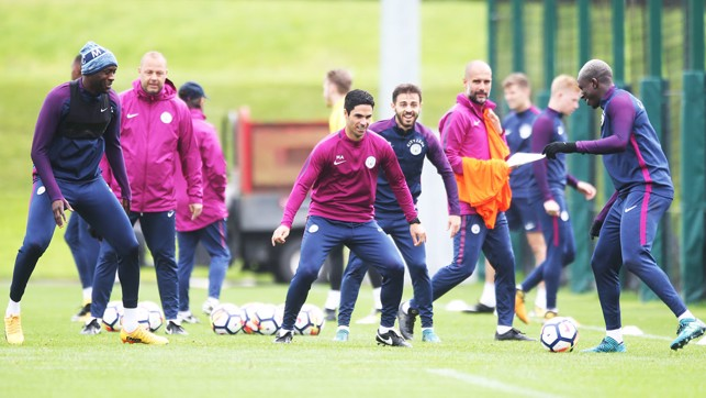 FUN AND GAMES: Mikel Arteta gets involved!